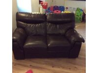 Two seater leather sofa.