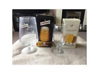 San Miguel and Stella Artois chalice glasses.