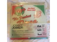 BNIB Joseph Joseph Chopping Board / Glass Worktop Saver