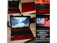 Red and Black Packard Bell Laptop - by ACER