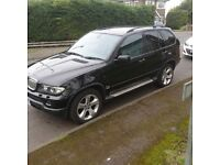 Black BMW X5 for sale. Heated front and rear seats, cd multichanger, leather interior. Loved car.