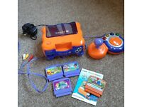 Vtech Vsmile TV Learning System- Orange Console and joystick with four games
