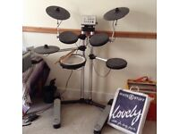 Roland HD-1 drum kit and stool.