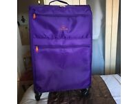 "Super light purple 4wheeled 28""suitcase used twice, excellent condition"