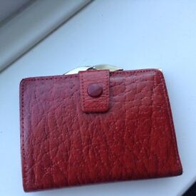 A Brand New and Unused Genuine Leather Red Compact Purse