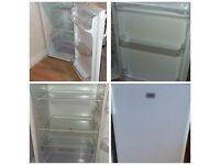 Undercounter white fridge and undercounter freezer.