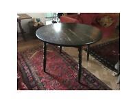 Circular dining table