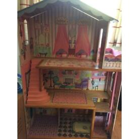 Dolls house 3 storey with some people and furniture
