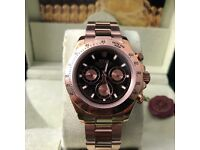 RoseGold with black face Daytona Rolex. Complete with Box, Bag & Paperwork.
