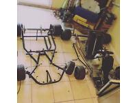 Two racing go karts with one engine