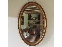 Large gilt frame oval mirror with bevel edge glass