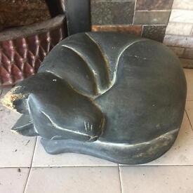 Wooden cat sleeping