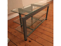 Designer Modern Media Unit / TV Stand. 3 shelves, toughened glass and steel. 1100w 520h 420d