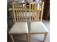 2 pine wood & cream leather dining chairs