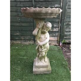 Stone garden bird bath
