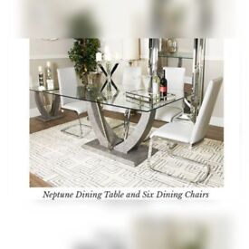 Brand new exclusive glass dining table and chairs