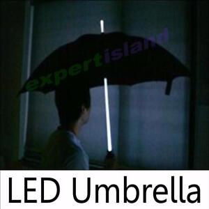 Now this is a bright idea! Illuminated LED Umbrella Lights Up for Safety with Bonus Built-in Flashlight in the Base