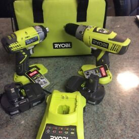 Ryobi 18 volt one + range hammer drill and 2 X impact drivers new with case