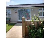 Long Beach, Norfolk coast. 2 bed bungalow, seaview, beach 2 mins walk, lovely garden, pets welcome