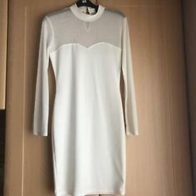 White size 6 long sleeved dress with netted sleeves