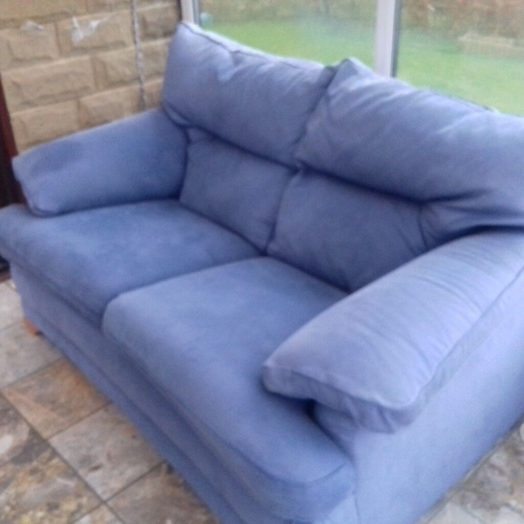 Two seater blue suede sofa