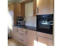 Solid wood light Oak kitchen for sale.