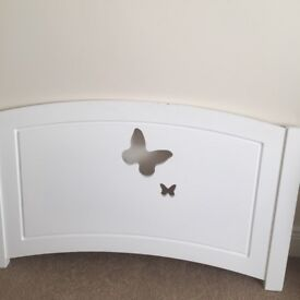 Girls single white bedstead with mattress and bedside table
