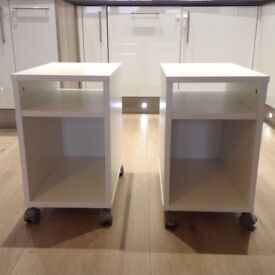 White bedside tables with wheels. 2 units.