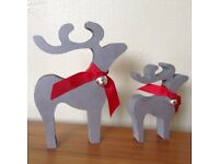 christmas star gazing reindeer decorations mother and baby silver bells red scarf ribbon