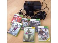 Xbox 360 with two controllers, headset and 5 games