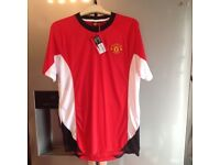 New with tags - size medium men's red, white and black shirt.