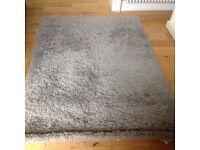 2 IKEA grey rugs