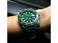Rolex Oyster Perpetual Green Bezel & Face
