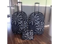 Two large sturdy suitcases with matching vanity case