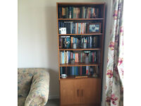 good quality bookcase with cupboard doors