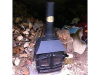 5 kilowatt KW Villager solid fuel wood burning stove with back boiler capabilities.
