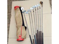 Vintage golf clubs. Circa 1980s. Made at St. Andrews Scotland. Youths size. Left handed.