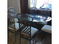 Glass dinning table and chairs with matching consol table good used condition