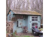 Childrens timber playhouse with shingle roof