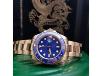 Gold rolex submariner blue ceramic bezel and blue face comes complete with bag box and papers
