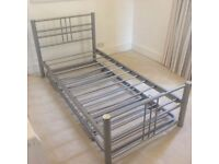 Stacking single divan beds including matching mattresses.