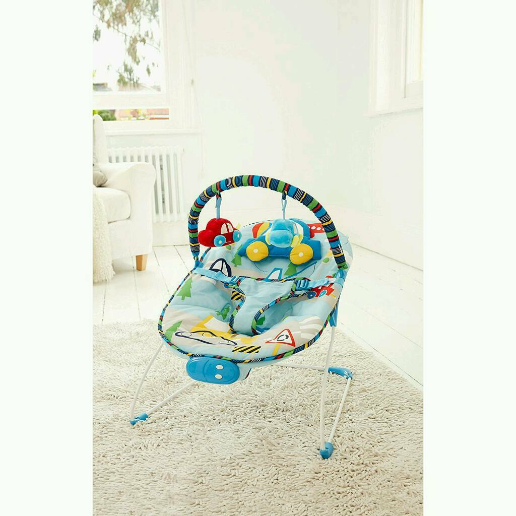 Mothercare Boys Vibrating Musical Bouncerin Cambridge, CambridgeshireGumtree - The ideal first seat for your newborn, this comfy baby bouncer features a bright and colourful transport print and two cute car toys to keep baby entertainedRemovable toy bar with 2 detachable 3D toysDetachable car shaped head support8 melodies3...