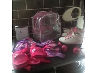 GIRLS ROLLER BOOTS SIZE12 AND PAD SET
