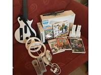 Wii package with guitar hero and mario kart and 6 games