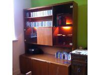 Wall unit/Display cabinet. Teak wood with smoke glass doors circa 1980