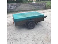 Wooden trailer with cover