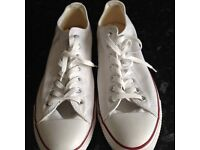 pair of size 12s converse canvas shoes never been worn white