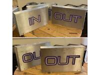 "Illuminated ""IN"" and ""OUT"" signs"