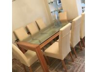 Dinning room table and 8 leather chairs - Immacualate condition