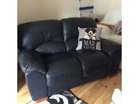 Two seater Soft Leather Sofa Navy Blue. Excerlant condition hardly used..